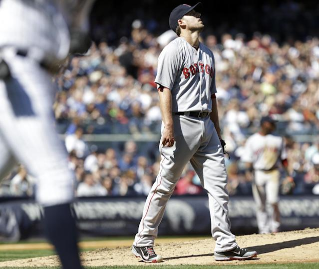 Boston Red Sox starting pitcher John Lackey reacts after New York Yankees' Alfonso Soriano hit a single during the sixth inning of a baseball game Saturday, April 12, 2014, in New York. (AP Photo/Frank Franklin II)