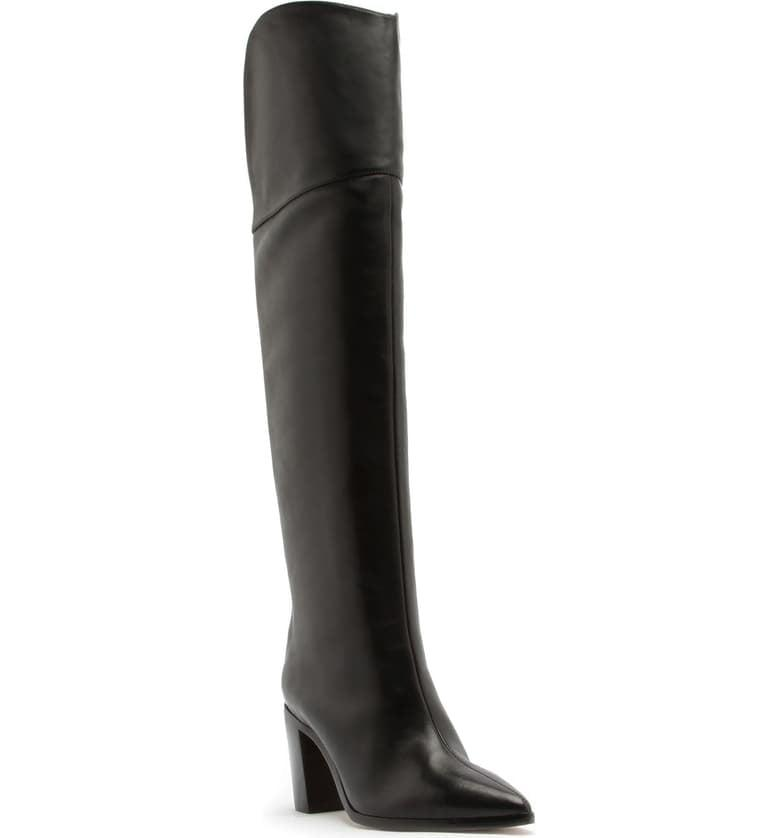 """<p>Pair these <a href=""""https://www.popsugar.com/buy/Schutz-Anaisha-Pointed-Toe-Over--Knee-Boots-482557?p_name=Schutz%20Anaisha%20Pointed%20Toe%20Over-the-Knee%20Boots&retailer=shop.nordstrom.com&pid=482557&price=340&evar1=fab%3Aus&evar9=43891444&evar98=https%3A%2F%2Fwww.popsugar.com%2Ffashion%2Fphoto-gallery%2F43891444%2Fimage%2F46603737%2FSchutz-Anaisha-Pointed-Toe-Over--Knee-Boots&list1=shopping%2Cfall%20fashion%2Cshoes%2Cboots%2Cfall&prop13=mobile&pdata=1"""" rel=""""nofollow"""" data-shoppable-link=""""1"""" target=""""_blank"""" class=""""ga-track"""" data-ga-category=""""Related"""" data-ga-label=""""https://shop.nordstrom.com/s/schutz-anaisha-pointed-toe-over-the-knee-boot-women/5384547?origin=category-personalizedsort&amp;breadcrumb=Home%2FWomen%2FShoes&amp;color=black"""" data-ga-action=""""In-Line Links"""">Schutz Anaisha Pointed Toe Over-the-Knee Boots</a> ($340) with a minidress.</p>"""