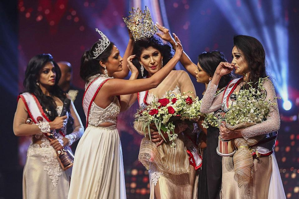 Mrs. World Gives Up Crown & Speaks Out After Being Arrested for Snatching  Tiara Off Mrs. Sri Lanka - Report Door