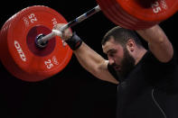 Simon Martirosyan of Armenia competes in the men's 109kg weightlifting event at the 2020 Summer Olympics, Tuesday, Aug. 3, 2021, in Tokyo, Japan. (AP Photo/Seth Wenig)