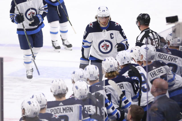 Winnipeg Jets forward Blake Wheeler (26) celebrates his goal during the first period of an NHL hockey game against the Buffalo Sabres, Sunday, Feb. 23, 2020, in Buffalo, N.Y. (AP Photo/Jeffrey T. Barnes)