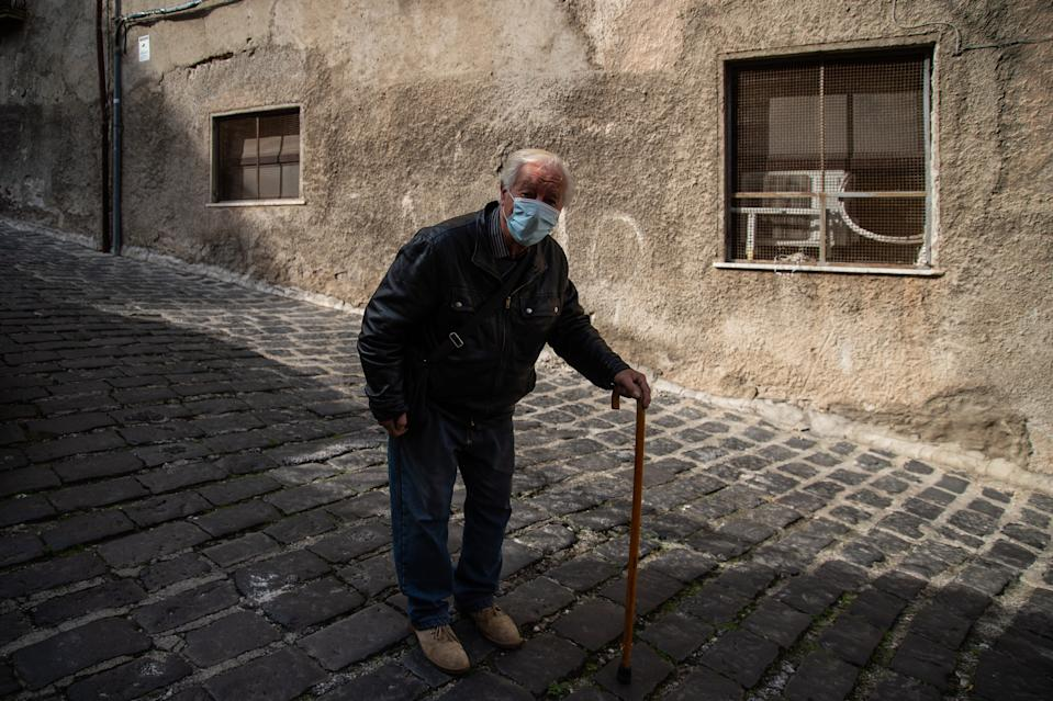 A man with a mask strolls in the old town on November 06, 2020 in Cosenza, Italy. (Photo by Ivan Romano/Getty Images)
