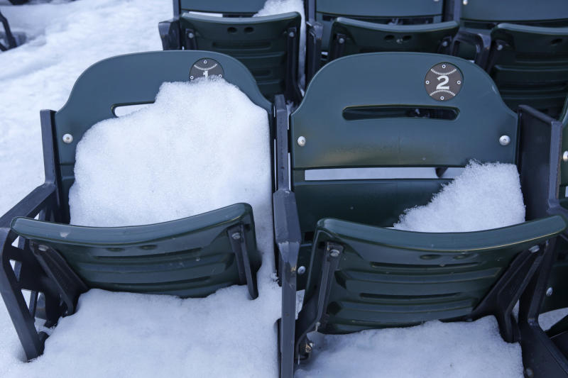 This Monday, March 17, 2014 photo taken in Chicago, shows snow covered front row seats at U.S. Cellular Field, home to the Chicago White Sox baseball team. The White Sox open their season on Monday, March 31, 2014, against the Baltimore Orioles. (AP Photo/M. Spencer Green)