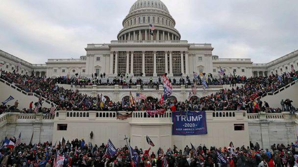 FILE PHOTO: A mob of supporters of U.S. President Donald Trump storm the U.S. Capitol Building in Washington, U.S., January 6, 2021. Picture taken January 6, 2021.  (Leah Millis/Reuters)