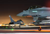 Image of a pair of RAF Typhoons waiting to taxi out and depart from RAF Akrotiri on an Op SHADER night mission (Picture: UK MOD/Crown 2019)