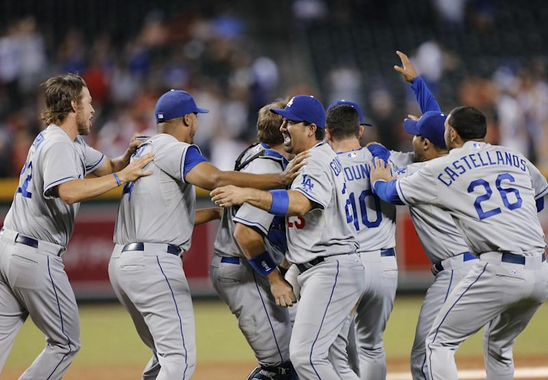 The Los Angeles Dodgers celebrate their 7-6 win over the Arizona Diamondbacks in a baseball game, Thursday, Sept. 19, 2013, in Phoenix. The Dodgers clinched the N.L. West title. (AP Photo/Matt York)