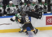 Dallas Stars' Radek Faksa (12) is checked by Vegas Golden Knights' Nick Cousins (21) during the third period of an NHL hockey playoff game Monday, Aug. 3, 2020, in Edmonton, Alberta. (Jason Franson/The Canadian Press via AP)