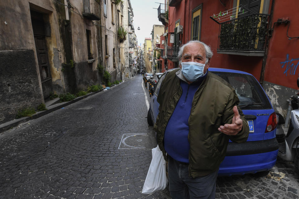 NAPLES, CAMPANIA, ITALY - 2020/04/19: Elderly man wearing a protective mask in the center of the city of Naples, after a government decree declaring all of Italy a protected area to combat covid-19 coronavirus infection. (Photo by Salvatore Laporta/KONTROLAB/LightRocket via Getty Images)