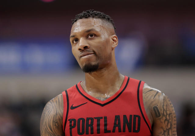 "<a class=""link rapid-noclick-resp"" href=""/nba/players/5012/"" data-ylk=""slk:Damian Lillard"">Damian Lillard</a> injured his left ankle Tuesday night. (AP)"