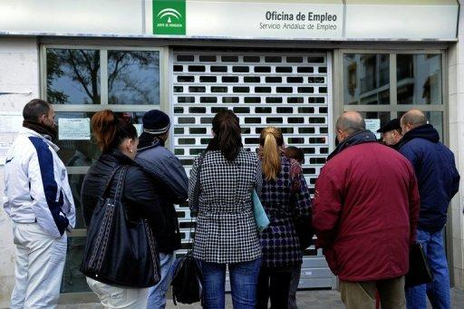 People wait in line in front of a government employment office in the Cruz Roja suburb of Sevilla. Spain has announced that its jobless rate surged to a record 24.4 percent at the end of March, pounding financial markets already reeling from a Spanish sovereign debt downgrade