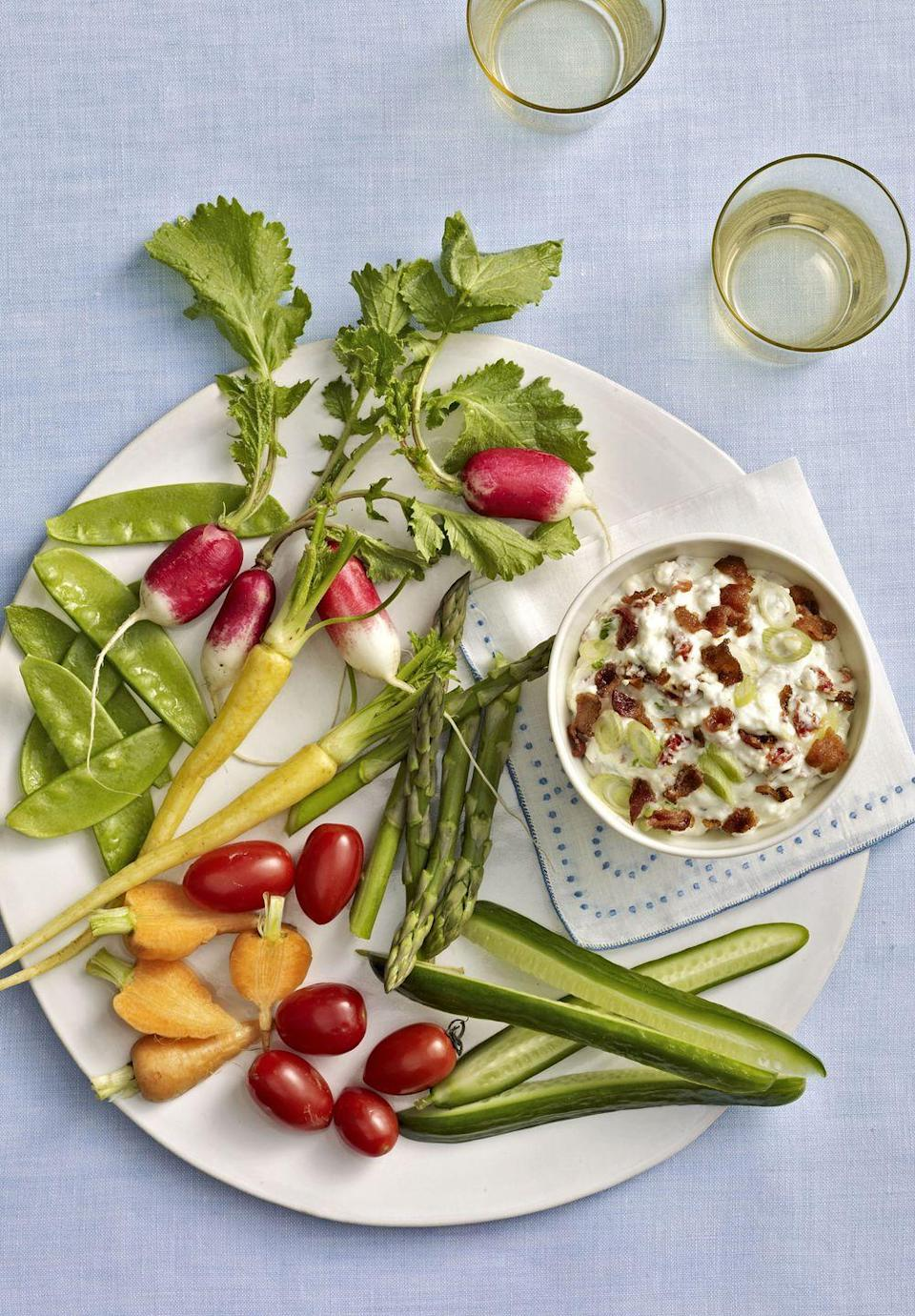 """<p>Our choice for the last dip to round out your party platters.</p><p><strong><a href=""""https://www.countryliving.com/food-drinks/recipes/a3359/bacon-dip-recipe/"""" rel=""""nofollow noopener"""" target=""""_blank"""" data-ylk=""""slk:Get the recipe"""" class=""""link rapid-noclick-resp"""">Get the recipe</a>.</strong></p>"""