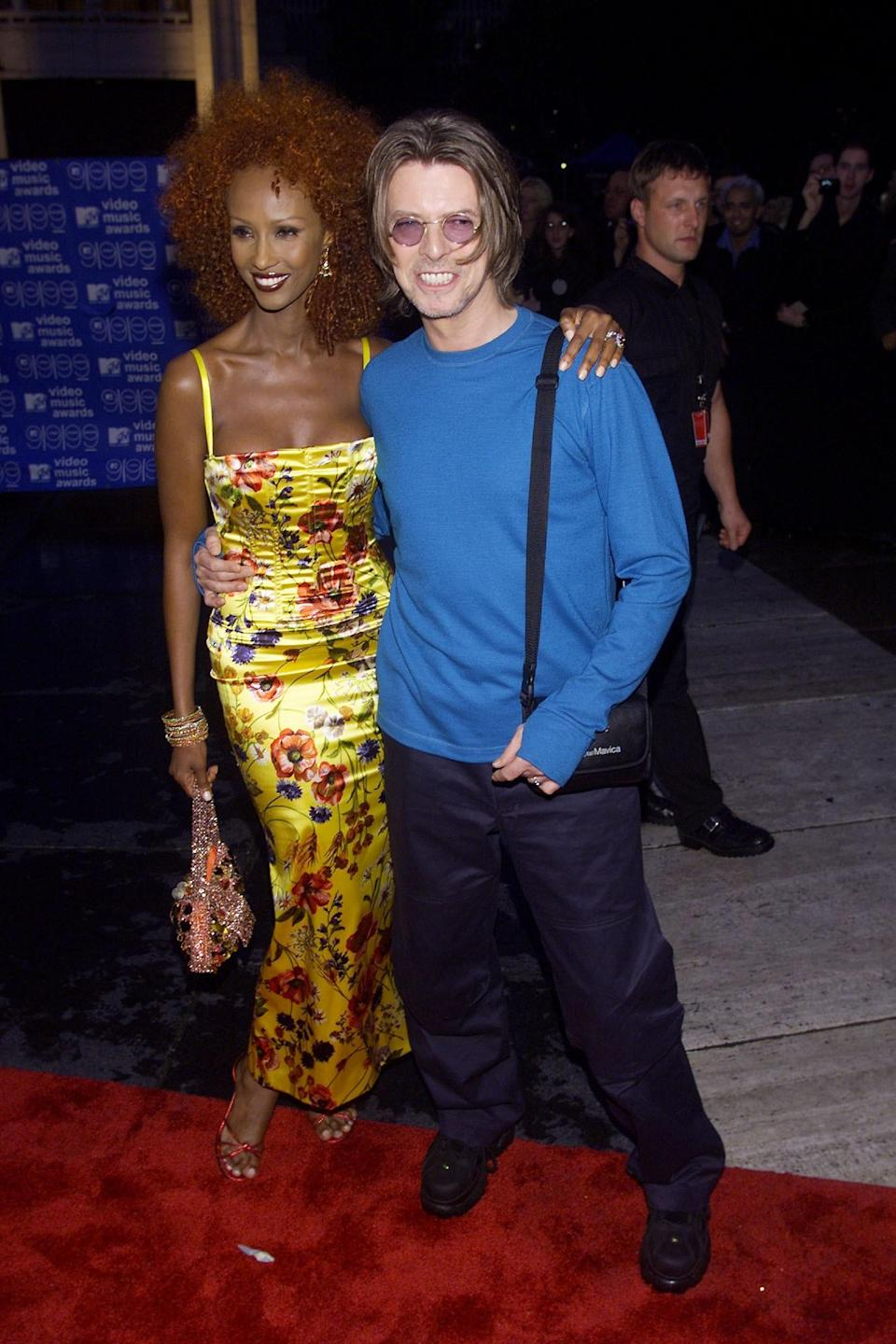 Long before Miranda Priestly schooled us on cerulean blue, David Bowie was wearing it on the red carpet. He clearly downplayed his fashion sense to let wife, supermodel, and now style mogul Iman radiate. Her floral number and red afro were beyond.