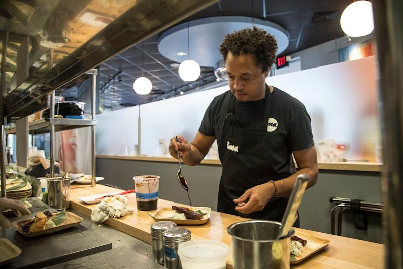 Michael Ransom, the owner-chef of ima prepares the third course during the Detroit Free Press/ Metro Detroit Chevy Dealers Top 10 Takeover of ima in Madison Heights, Tuesday, August 13, 2019.