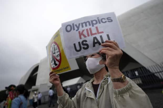 The Tokyo Olympics will get underway in less than two weeks under a state of emergency in Japan's capital and amid opposition from those who fear the potential public health consequences of hosting the international event during a pandemic. (Eugene Hoshiko/The Associated Press - image credit)