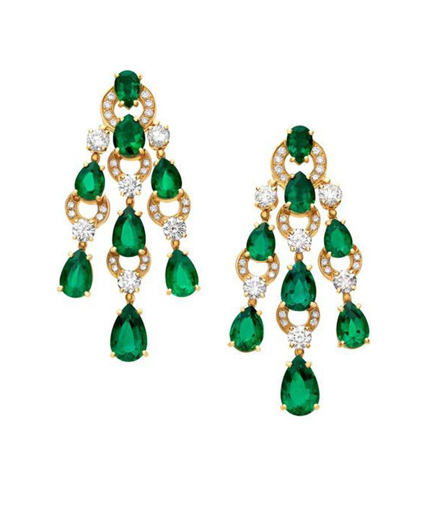 <p>High jewelry 18-karat yellow gold with emerald and diamond earrings, price upon request. Call 1.800.BVLGARI for more information. </p>