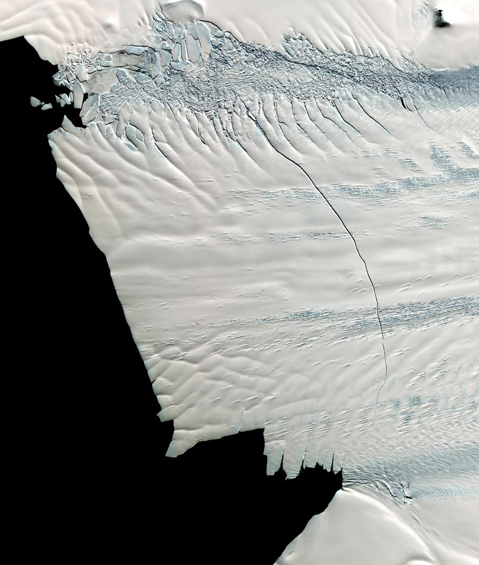 In mid-October 2011, NASA scientists working in Antarctica discovered a massive crack across the Pine Island Glacier, a major ice stream that drains the West Antarctic Ice Sheet. Extending for 19 miles, the crack was 260 feet wide and 195 feet deep. Eventually, the crack will extend all the way across the glacier, and calve a giant iceberg that will cover about 350 square miles. This image from the ASTER instrument on NAS's Terra spacecraft was acquired Nov. 13, 2011 and covers an area of 27 by 32 miles , and is located near 74.9 degrees south latitude, 101.1 degrees west longitude.