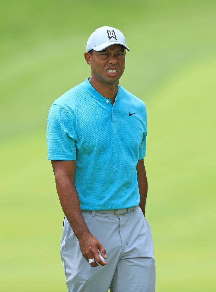 Tiger Woods reacts after missing a putt in the second round of the US PGA Tour's Memorial Tournament (AFP Photo/SAM GREENWOOD)