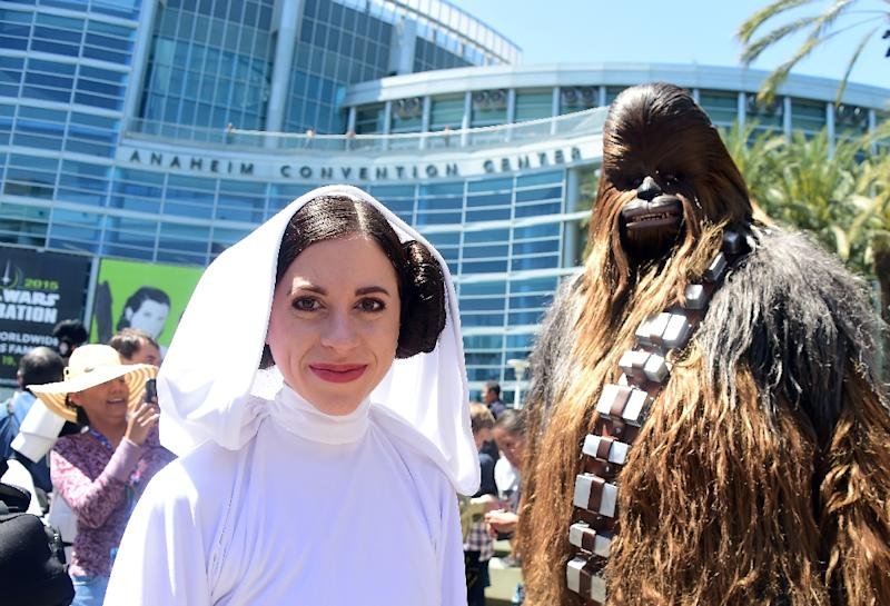 Star Wars fans dressed in costume attend the opening day of the 25th Star Wars Convention on April 16, 2015 in Anaheim, California (AFP Photo/Frederic J. Brown)