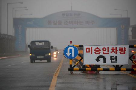 A traffic sign is seen on the Grand Unification Bridge which leads to the truce village Panmunjom, just south of the demilitarized zone separating the two Koreas, in Paju, South Korea, May 16, 2018.   REUTERS/Kim Hong-Ji