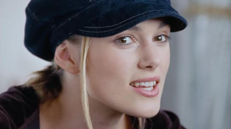 Keira Knightley in a hat (zit not pictured). (Photo: Universal)