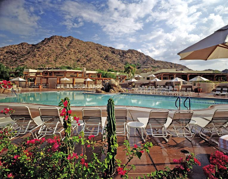 This undated image released by JW Marriott Camelback Inn Resort & Spa shows the Jack Rabbit pool at the JW Marriott Camelback Inn Resort & Spa in Scottsdale, Ariz. Twenty years ago, many Phoenix-area resorts shut down for the summer because of the heat, but now substantial deals are offered that attract locals and tourists alike. (AP Photo/JW Marriott Camelback Inn Resort & Spa)