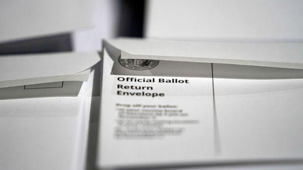 PHOTO: Stacks of ballot envelopes waiting to be mailed are seen at the Wake County Board of Elections in Raleigh, N.C. (Gerry Broome/AP, FILE)