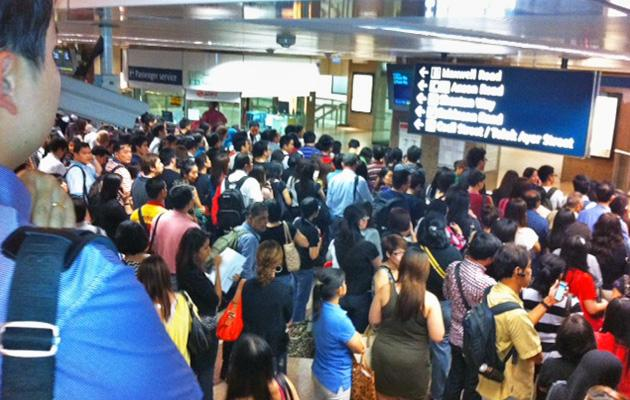 Huge commuter jam at Tanjong Pagar MRT station due to a reported train fault. Ticket gantries were also closed.