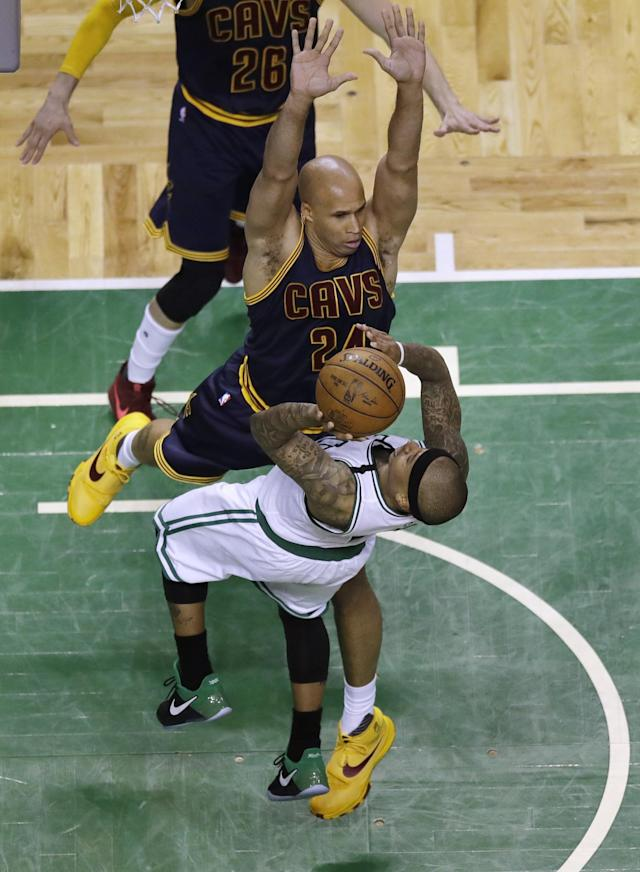 <p>Boston Celtics guard Isaiah Thomas, front, drives into the defense of Cleveland Cavaliers forward Richard Jefferson during the fourth quarter of Game 1 of the NBA basketball Eastern Conference finals, Wednesday, May 17, 2017, in Boston. (AP Photo/Charles Krupa) </p>