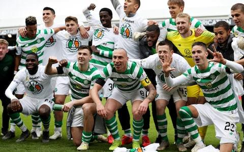 Celtic celebrate winning the title earlier this month - Credit: Getty Images