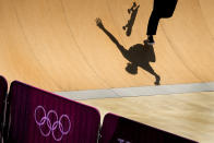 An athlete from Belgium practices for the skateboarding competition at the 2020 Summer Olympics, Tuesday, July 20, 2021, at the Ariake Urban Sports Park in Tokyo. (AP Photo/Charlie Riedel)