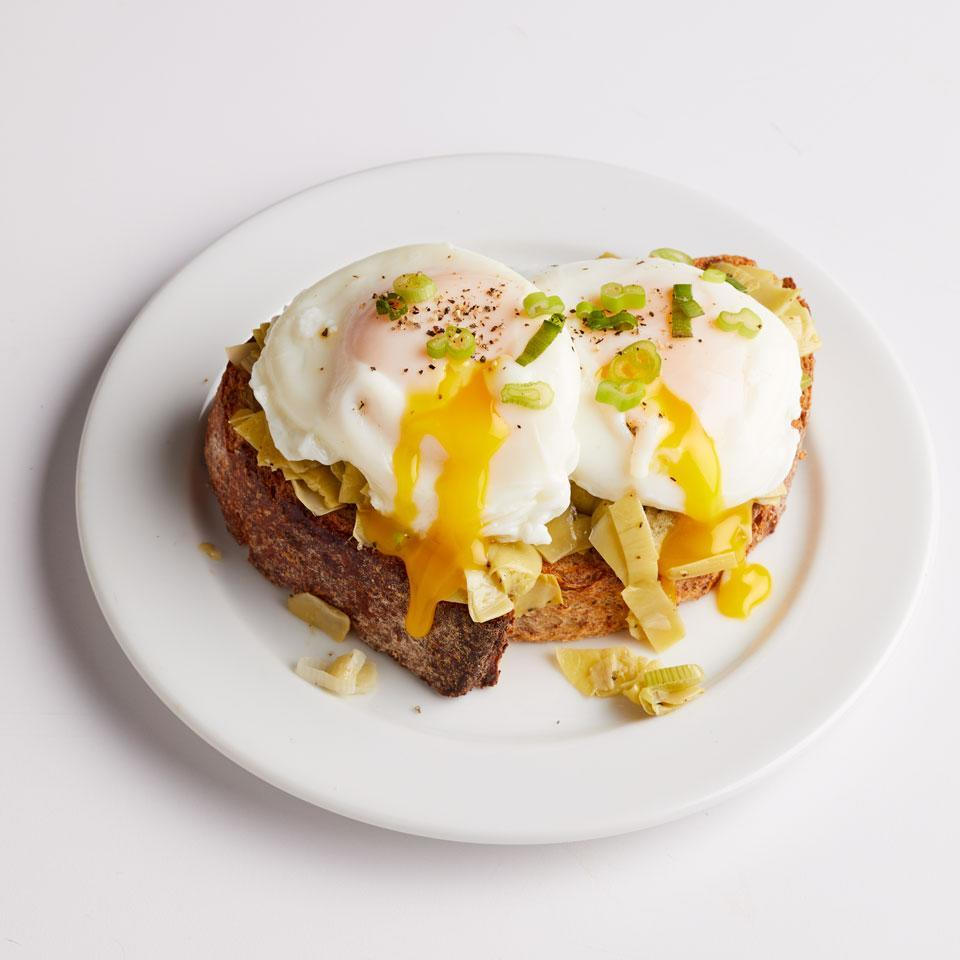 "<p>For a Mediterranean-inspired breakfast, serve up fried or poached eggs on top of sautéed artichokes and toast. If you can't find frozen, be sure to rinse canned artichoke hearts well--they're saltier than frozen. Serve with hot sauce on the side, if desired. <a href=""http://www.eatingwell.com/recipe/258519/artichoke-egg-tartine/"" rel=""nofollow noopener"" target=""_blank"" data-ylk=""slk:View recipe"" class=""link rapid-noclick-resp""> View recipe </a></p>"
