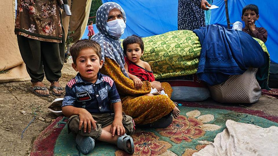 An Afghan family who fled fighting in Kunduz province sit at a makeshift camp in Hasa-e-Awal Park, in Kabul, Afghanistan - 14 August 2021
