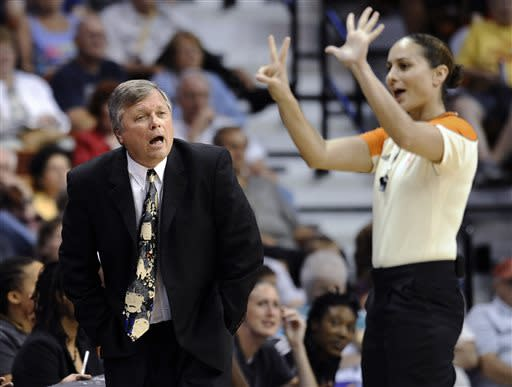 San Antonio Silver Stars coach Dan Hughes, left, reacts to a call by official Tiara Cruse, right, during the second half of a WNBA basketball game against the Connecticut Sun in Uncasville, Conn., Sunday, July 14, 2013. Connecticut won 86-84. (AP Photo/Jessica Hill)