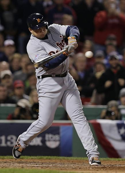 File-This Oct. 19, 2013 file photo shows Detroit Tigers' Miguel Cabrera hitting a single off Boston Red Sox starting pitcher Clay Buchholz in the sixth inning during Game 6 of the American League baseball championship series in Boston. Cabrera has won his second straight player of the year award in voting by his fellow major leaguers. Cabrera followed his Triple Crown season of 2012 with another impressive year. He led the American League with a .348 average and had 44 homers and 137 RBIs, both second to Baltimore's Chris Davis. Cabrera edged Davis and the Angels' Mike Trout for the honor. (AP Photo/Charles Krupa, File)