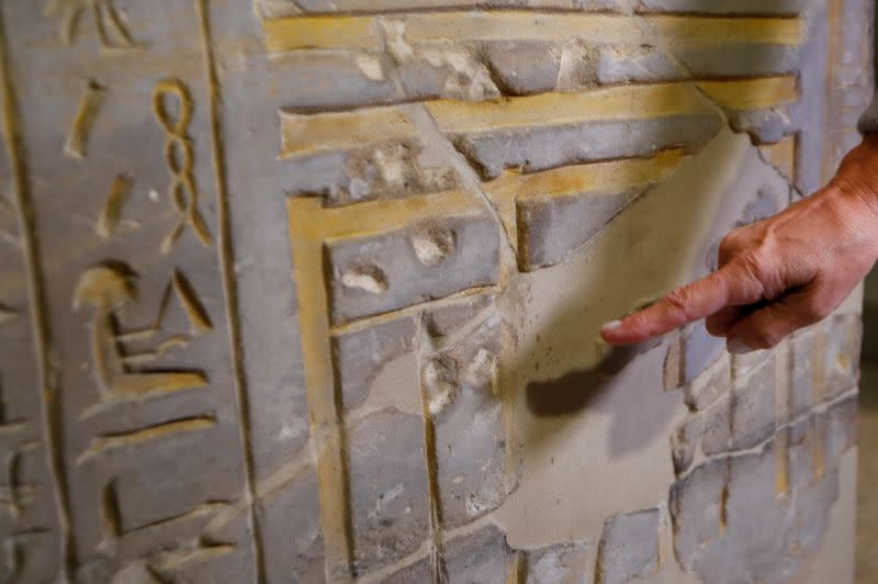 Friederike Seyfried, Director of the Egyptian Museum and Papyrus Collection shows damages, in Berlin