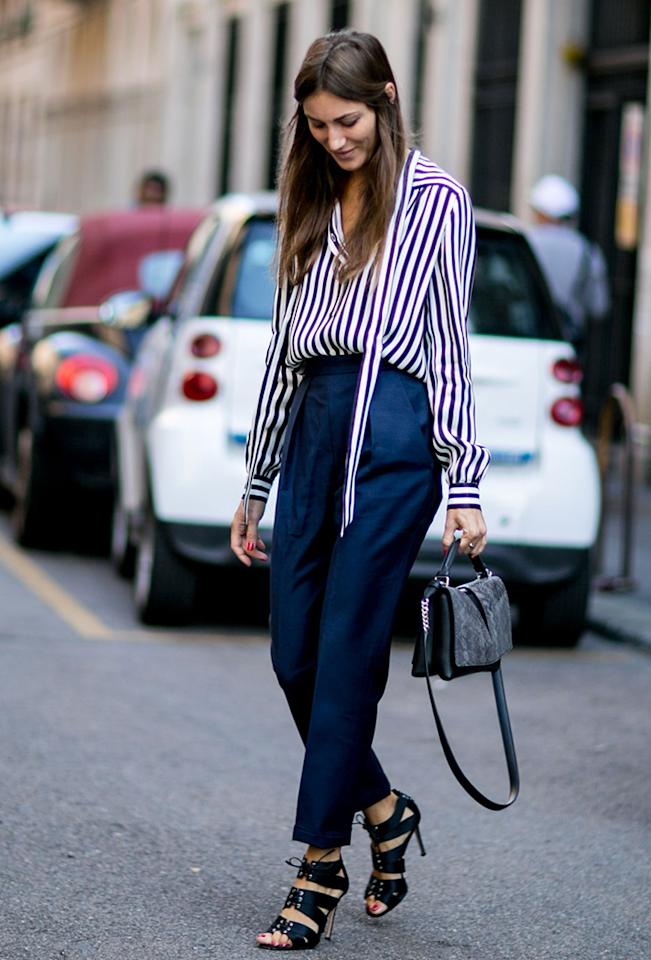 How to nail the elusive French Girl Look for your 9-to-5: cropped navy trousers, a striped silk blouse, and a pair of vertiginous heels. (Carine would approve.)