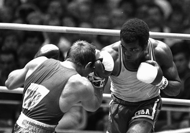 FILE - In this Aug. 2, 1980, file photo, Cuba's Teofilo Stevenson goes to work on Soviet opponent Pyotr Zaev to win the heavyweight bout at the Moscow Olympics. Stevenson died on Monday, June 11, 2012, at the age of 60. (AP Photo, file)