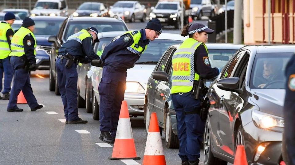 Police in the New South Wales (NSW) border city of Albury check cars crossing the state border from Victoria on July 8, 2020