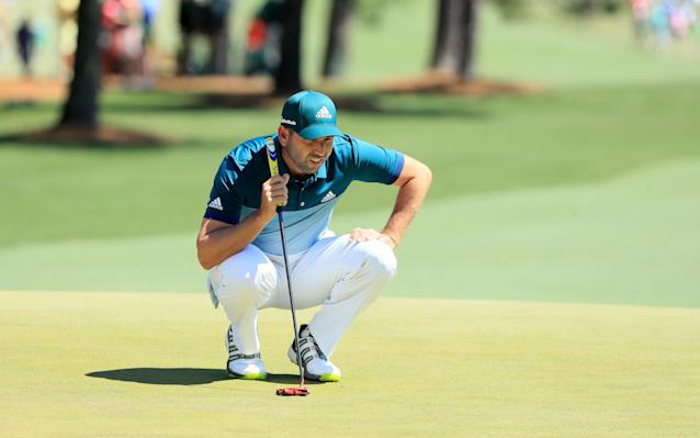 <span>Sergio Garcia lines up a putt at the final round of the Masters</span>