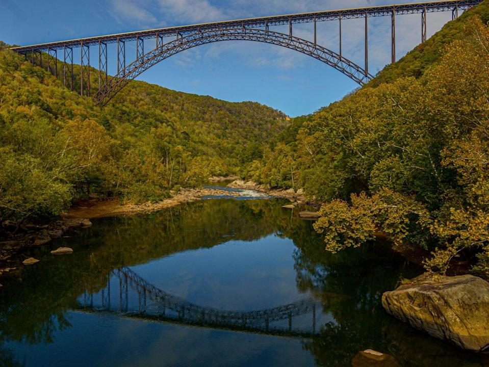 <p>The New River Gorge Bridge is seen from Fayette Station in Fayetteville, WVa A program launched Monday on 12 April 2021</p> ((AP))