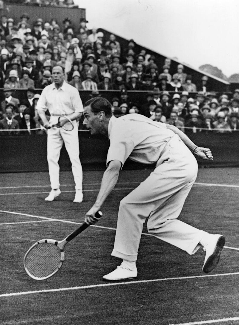 The Duke of York, later George VI (1895 - 1952), playing in a doubles match at Wimbledon with his partner Wing Commander Louis Greig in 1926. The Duke was an ace tennis player. Photo courtesy of Getty Images.