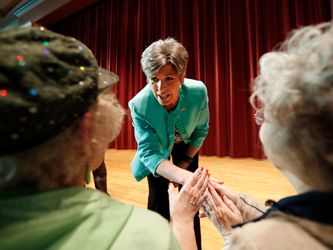 Sen. Joni Ernst greets constituents at a town hall in Iowa on Tuesday.