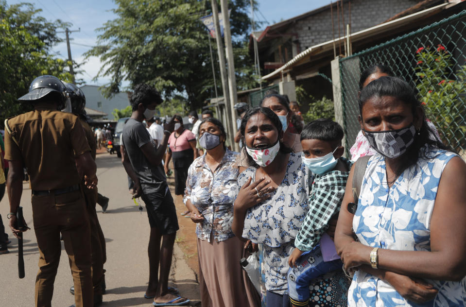 Family members of the inmates of Sri Lanka's Mahara prison complex gather demanding to know the present condition of their relatives following an overnight unrest in Mahara, on the outskirts of Colombo, Sri Lanka, Monday, Nov. 30, 2020. Sri Lankan officials say six inmates were killed and 35 others were injured when guards opened fire to control a riot at a prison on the outskirts of the capital. Two guards were critically injured. Pandemic-related unrest has been growing in Sri Lanka's overcrowded prisons. (AP Photo/Eranga Jayawardena)