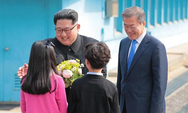 """<span class=""""element-image__caption"""">North Korean leader Kim Jong-un and South Korean President Moon Jae-in with children presenting flowers to Kim.</span> <span class=""""element-image__credit"""">Photograph: Anadolu Agency/Getty Images</span>"""