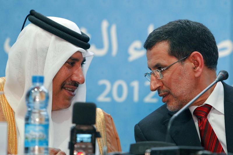 Qatar's Prime Minister and Foreign Minister, Sheik Hamad bin Jassim al-Thani, left, chats with Morocco's Foreign Minister, Saad Eddine El Othmani at a press conference following the meeting of the Friends of the Syrian People in Marrakech, Morocco, Wednesday, Dec. 12, 2012. More than 100 countries on Wednesday recognized a new Syrian opposition coalition, opening the way for greater humanitarian assistance to the forces battling Bashar Assad and possibly even military aid. (AP Photo/Abdeljalil Bounhar)