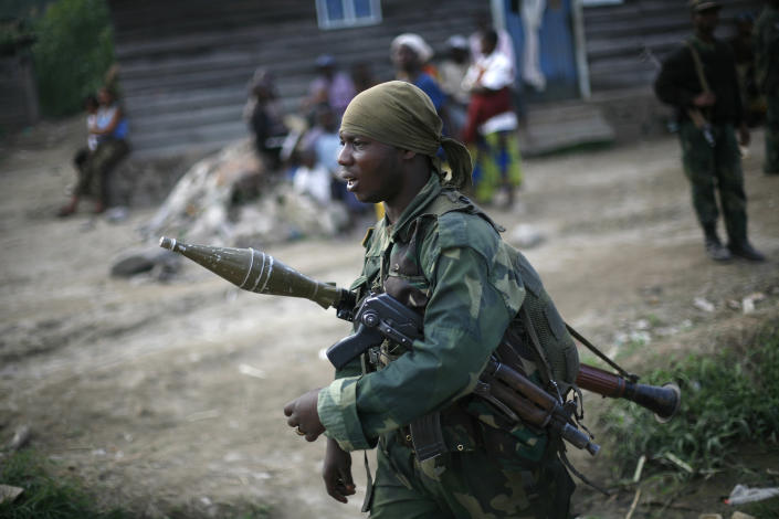 FARDC Congolese government troops patrol near Minova Congo, some 40 mms south-west of Goma, Thursday Nov. 29, 2012. M23 Rebels, who last week seized one of the most important cities in eastern Congo and advanced beyond, said Thursday that they had pulled back several miles (kilometers ) to the town of Sake and were on track to leave the key city of Goma by Friday, in accordance with a deadline imposed by the international community. Governement troops were massing in Minova.(AP Photo/Jerome Delay)