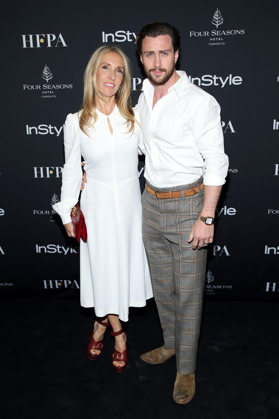 "<p>In 2009, Sam Taylor-Johnson announced her engagement to Aaron Taylor-Johnson, who's 23 years her junior. According to <a href=""http://www.dailymail.co.uk/tvshowbiz/article-2602579/Aaron-Taylor-Johnson-shrugs-23-year-age-gap-wife-Sam.html"" rel=""nofollow noopener"" target=""_blank"" data-ylk=""slk:The Daily Mail"" class=""link rapid-noclick-resp""><em>The Daily Mail</em></a>, the two met on the set of <em>Nowhere Boy</em>, where Sam was the director. Of the age gap, Aaron reportedly told <a href=""http://www.dailymail.co.uk/tvshowbiz/article-2602579/Aaron-Taylor-Johnson-shrugs-23-year-age-gap-wife-Sam.html"" rel=""nofollow noopener"" target=""_blank"" data-ylk=""slk:Men's Health"" class=""link rapid-noclick-resp""><em>Men's Health</em></a> in a 2014 interview: ""She's such a young, beautiful soul that you wouldn't even know.""</p>"