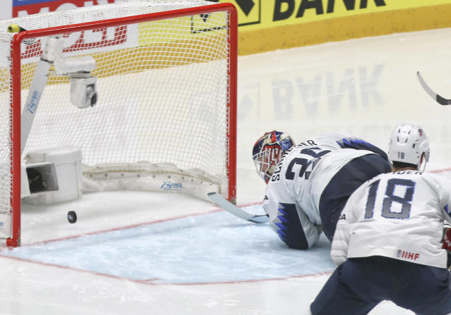 Goaltender Cory Schneider of the US fails to stop a shot by Russia's Kirill Kaprizov during the Ice Hockey World Championships quarterfinal match between Russia and the United States at the Steel Arena in Bratislava, Slovakia, Thursday, May 23, 2019. (AP Photo/Ronald Zak)