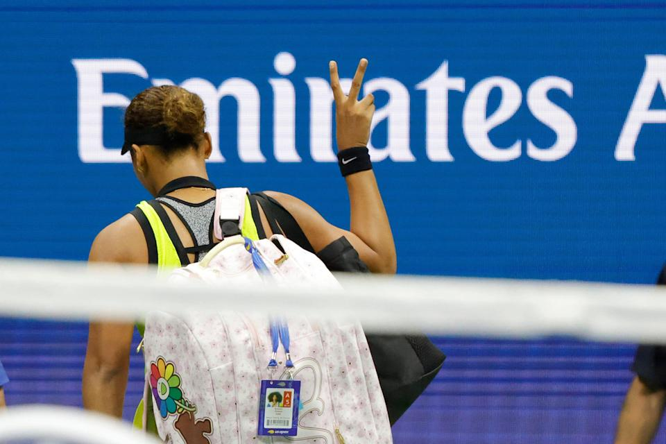 Naomi Osaka gestures as she leaves the court after losing to Leylah Fernandez at the U.S. Open.