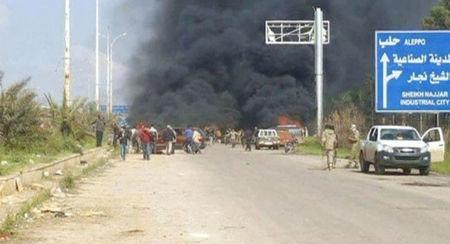Still image shows a cloud of black smoke rising from vehicles in the distance in what is said to be Aleppo's outskirts